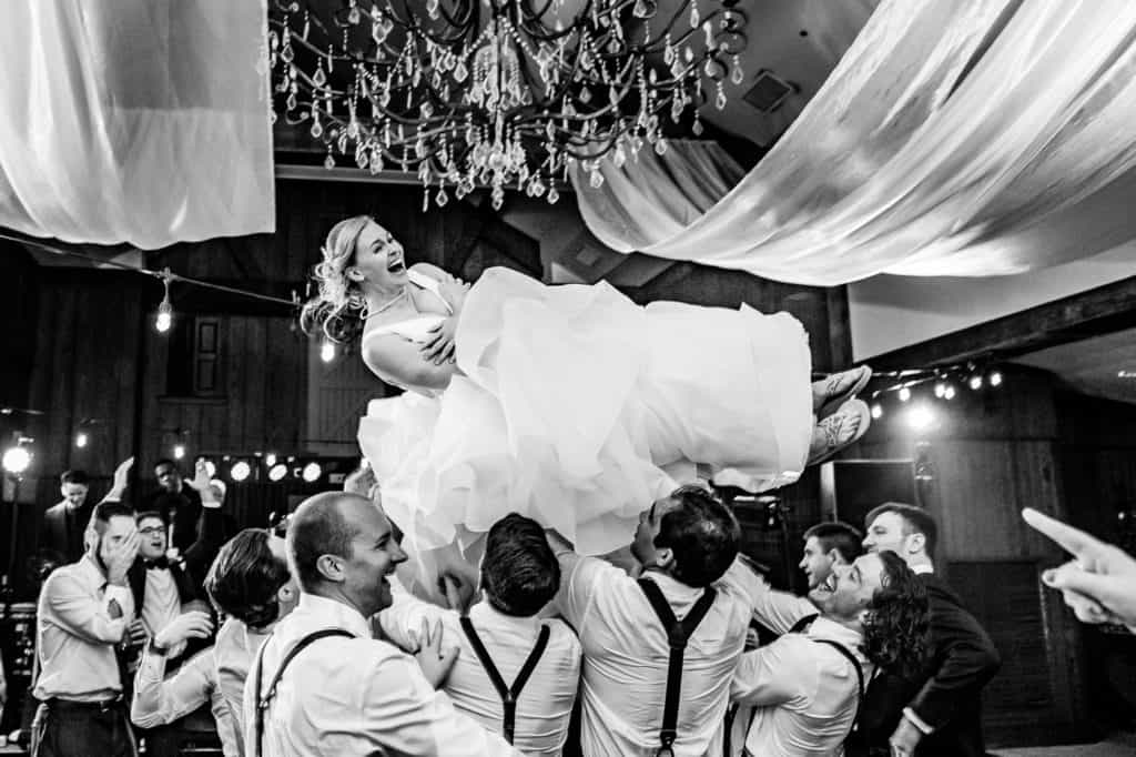 bride being tossed into the air