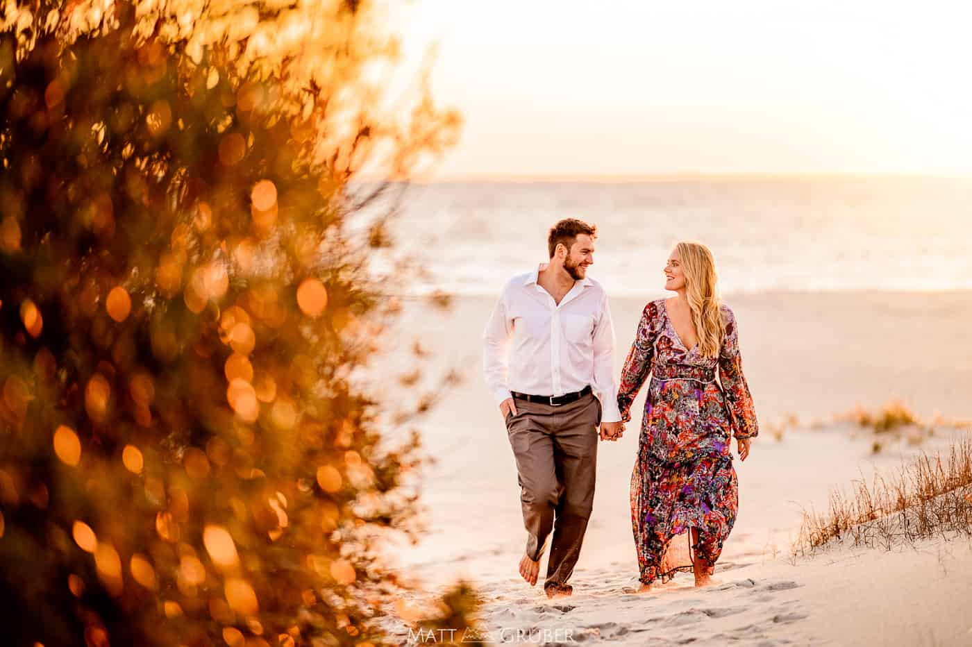 Bride and groom walking through the beach path in Cape May