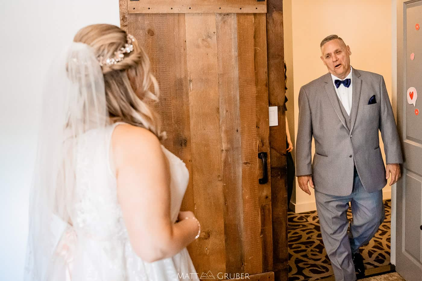 bride's first look with dad at chestnut hill hotel carriage barn