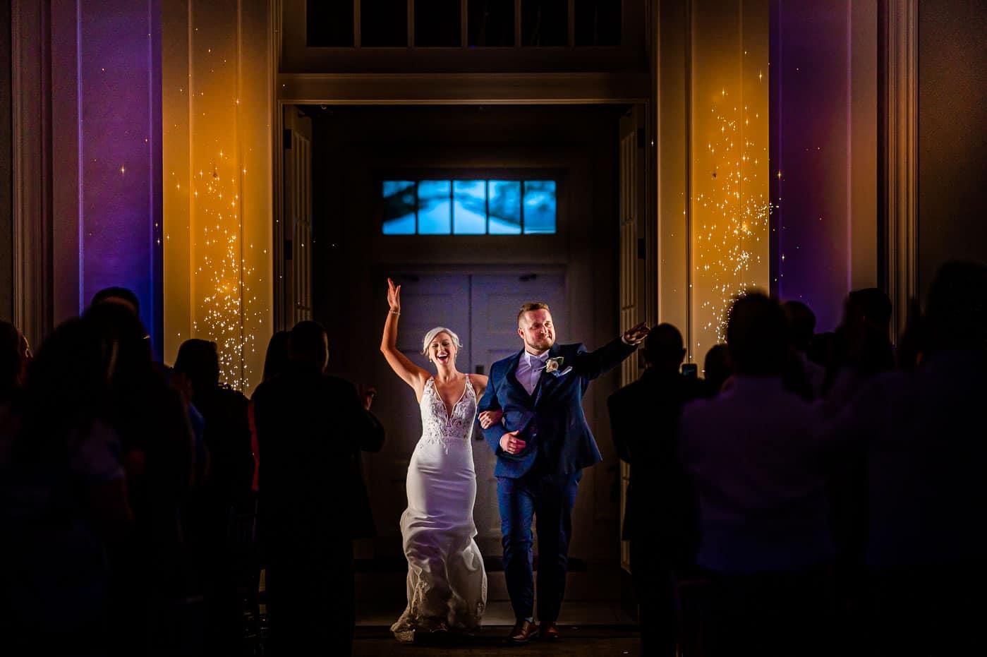 sparkler entrance for bride and groom at the ballroom at ellis preserve
