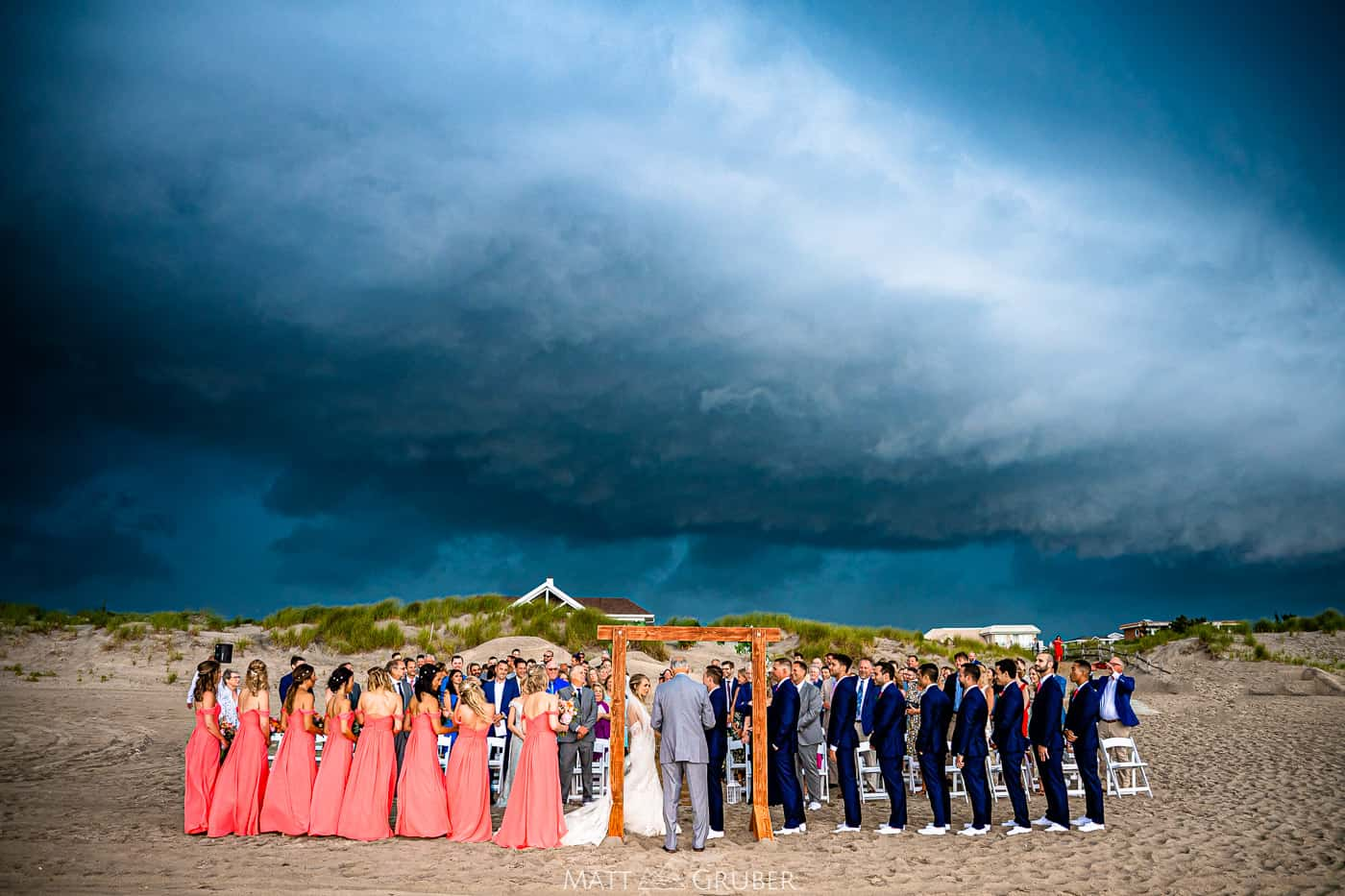 a summer storm rolls through a wedding ceremony at ICONA Avalon