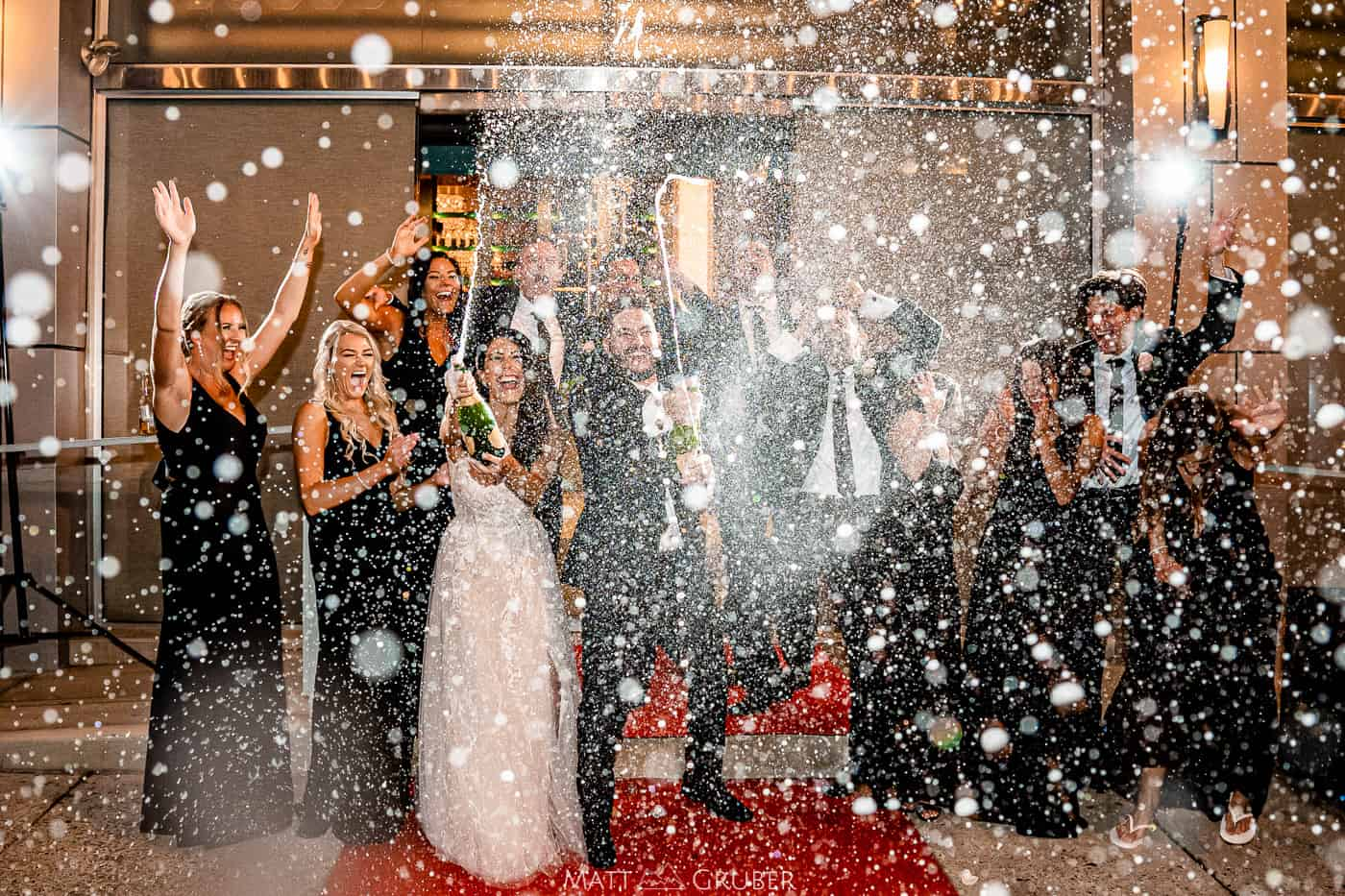 bridal party spraying champagne outside tendency by cescaphe